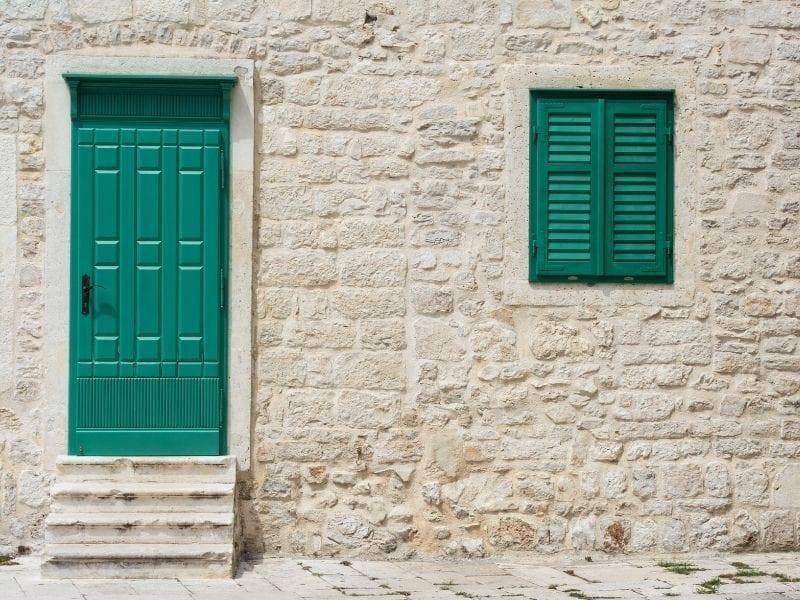 Green wood door with window shutters - JTD